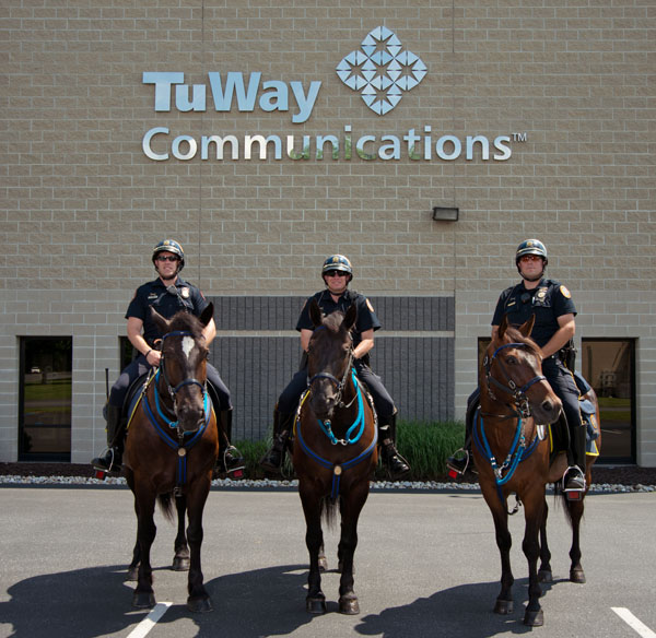 Pictured, from left to right, are mounted Officers Leaser, Brooks and Buskirk.  Their respective partners are George, Raven and Pharaoh.